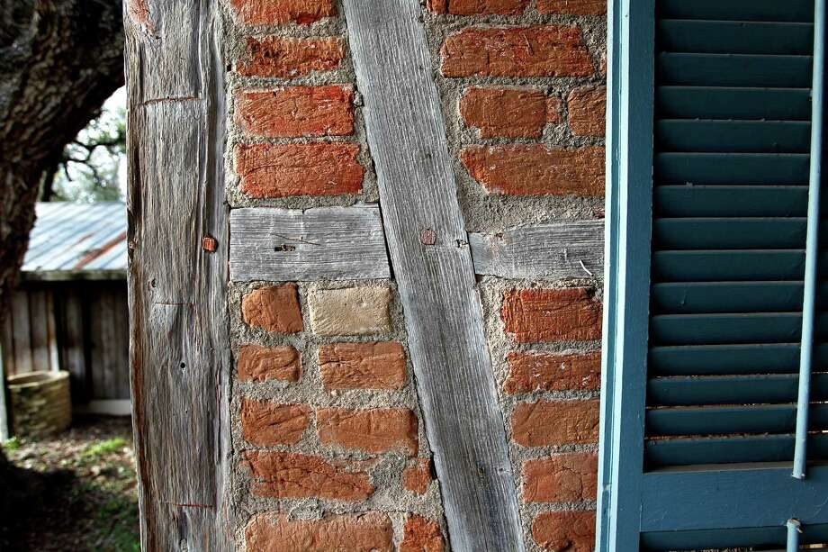 "The J.C. Stiehl family home built in 1852 is featured in Buildings of Texas Volume 1 written by Gerald Moorhead Tuesday, Jan. 29, 2013, in La Grange. The home is German ""fachwerk"" using handmade brick and hand hewn cedar timbers joined with wooden pegs Photo: Johnny Hanson, Houston Chronicle / © 2013  Houston Chronicle"