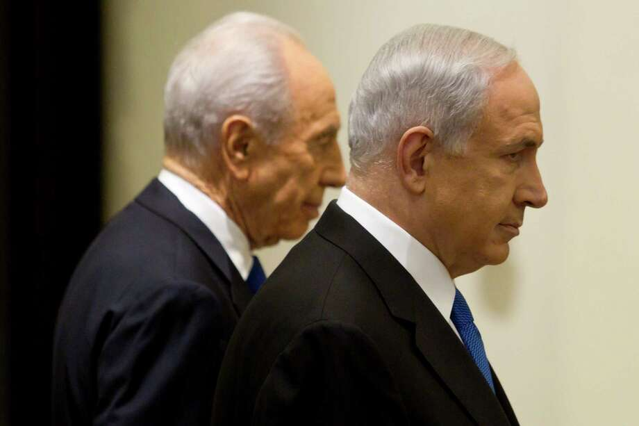 "Israeli Prime Minister Benjamin Netanyahu (right), shown with President Shimon Peres, said his next government would be ""committed to peace."" Photo: Jim Hollander, Associated Press / POOL EPA"