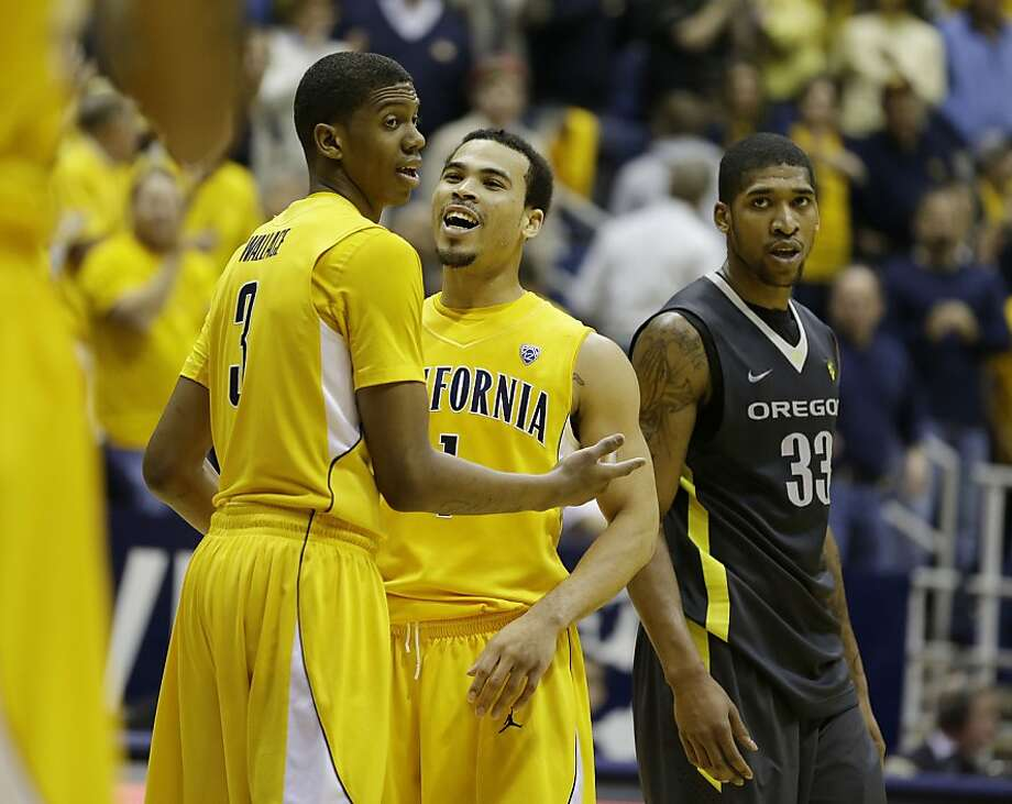 Cal guards Tyrone Wallace (3) and Justin Cobbs celebrate in the closing seconds of the home win over No. 10 Oregon. Photo: Eric Risberg, Associated Press