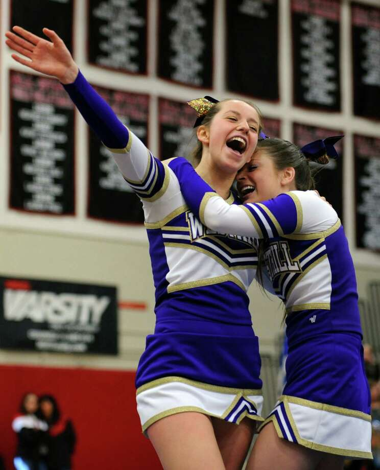 Westhill's Callie Rozsa, left, and Emily Fitzpatrick celebrate after completing their routine during the FCIAC cheerleading championships Saturday, Feb. 2, 2013 at Fairfield Warde High School in Fairfield, Conn. Photo: Autumn Driscoll / Connecticut Post