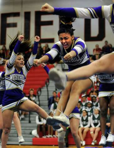 Westhill's Moriah Bass competes with her team during the FCIAC cheerleading championships Saturday, Feb. 2, 2013 at Fairfield Warde High School in Fairfield, Conn. Photo: Autumn Driscoll / Connecticut Post