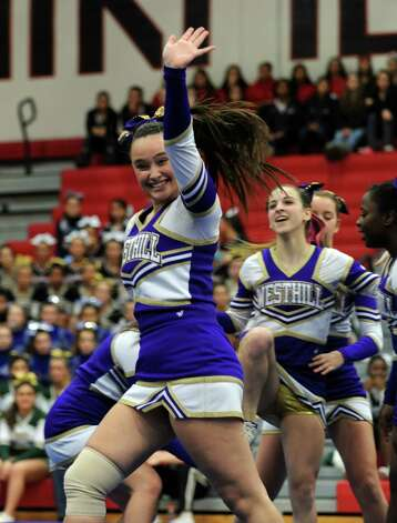 Westhill competes in the FCIAC cheerleading championships Saturday, Feb. 2, 2013 at Fairfield Warde High School in Fairfield, Conn. Photo: Autumn Driscoll / Connecticut Post
