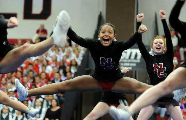 New Canaan's Taaijah Carrafiello competes with her team during the FCIAC cheerleading championships Saturday, Feb. 2, 2013 at Fairfield Warde High School in Fairfield, Conn. Photo: Autumn Driscoll / Connecticut Post