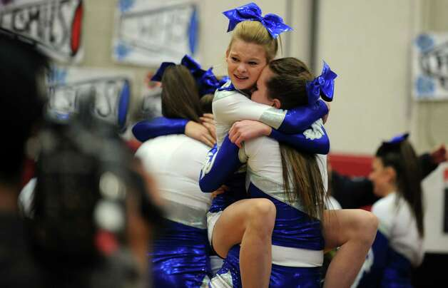 Fairfield Ludlowe's Katie Grant, left, and Tess Atkins celebrate after completing their routine during the FCIAC cheerleading championships Saturday, Feb. 2, 2013 at Fairfield Warde High School in Fairfield, Conn.  Fairfield Ludlowe took first place in the competition. Photo: Autumn Driscoll / Connecticut Post
