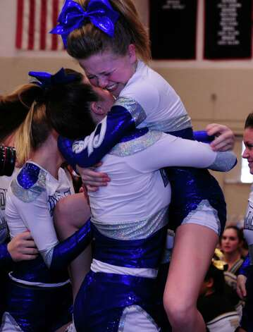 Fairfield Ludlowe High School cheerleaders celebrate their first place win in the FCIAC cheerleading championships Saturday, Feb. 2, 2013 at Fairfield Warde High School in Fairfield, Conn. Photo: Autumn Driscoll / Connecticut Post