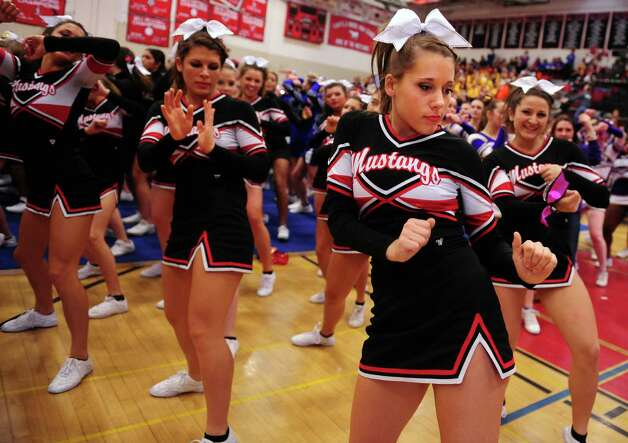 Fairfield Warde's Cozette Moore dances with teammates as they wait for results during the FCIAC cheerleading championships Saturday, Feb. 2, 2013 at Fairfield Warde High School in Fairfield, Conn. Photo: Autumn Driscoll / Connecticut Post