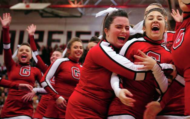 Greenwich cheerleaders Amanda Rosabella, left, hugs Kaitlyn Cunningham after finishing their routine during the FCIAC cheerleading championships Saturday, Feb. 2, 2013 at Fairfield Warde High School in Fairfield, Conn. Photo: Autumn Driscoll / Connecticut Post
