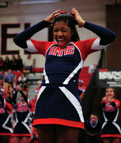 Brien McMahon High School cheerleaders compete in the FCIAC cheerleading championships Saturday, Feb. 2, 2013 at Fairfield Warde High School in Fairfield, Conn. Photo: Autumn Driscoll / Connecticut Post
