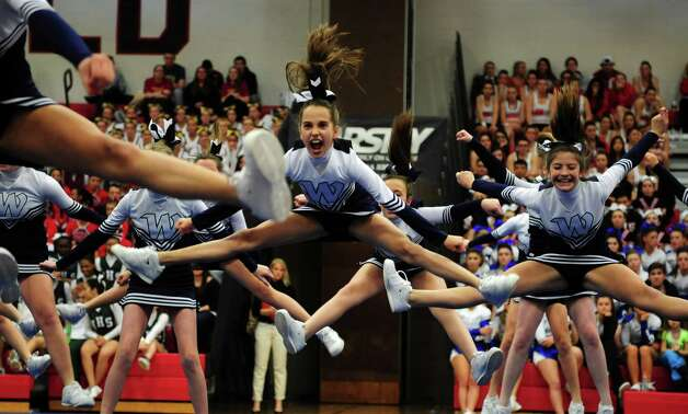Scenes from the FCIAC cheerleading championships Saturday, Feb. 2, 2013 at Fairfield Warde High School in Fairfield, Conn. Photo: Autumn Driscoll / Connecticut Post