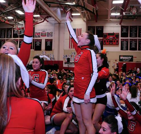 Greenwich's Coco Vaccari, center, and her teammates celebrate their second place win in the FCIAC cheerleading championships Saturday, Feb. 2, 2013 at Fairfield Warde High School in Fairfield, Conn. Photo: Autumn Driscoll / Connecticut Post