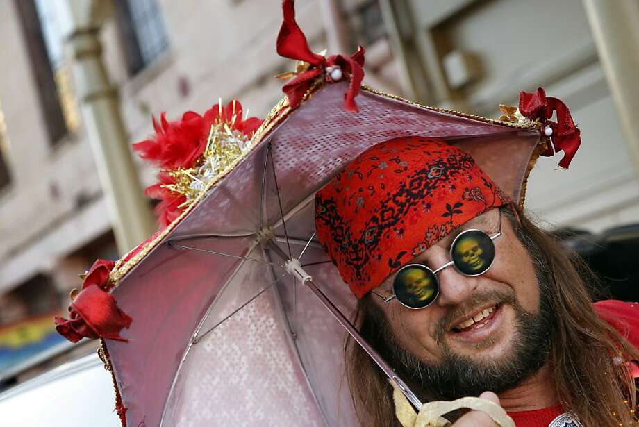 49ers fan Robert Chewning of Ukiah came prepared with a red and gold parasol to Decatur Street in New Orleans. 49ers fans poured out on the streets in New Orleans, La., on Saturday, February 2, 2013, the day before the 49ers played in Super Bowl XLVII Photo: Carlos Avila Gonzalez, The Chronicle