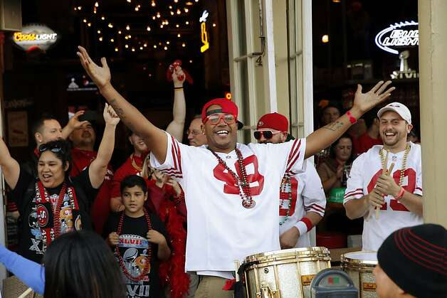 Montoya of the Niner Noise drum line is happy to see a crowd of 49ers fans on Decatur Street in New Orleans. Photo: Carlos Avila Gonzalez, The Chronicle