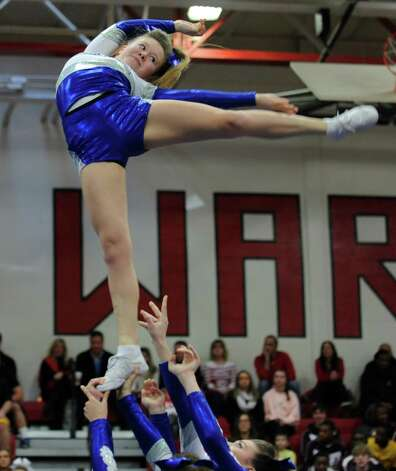 Fairfield Ludlowe cheerleaders compete in the FCIAC cheerleading championships Saturday, Feb. 2, 2013 at Fairfield Warde High School in Fairfield, Conn.  Fairfield Ludlowe took first place in the competition. Photo: Autumn Driscoll / Connecticut Post