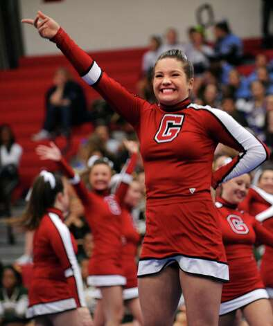 Greenwich's Mary Andrews competes with her team during the FCIAC cheerleading championships Saturday, Feb. 2, 2013 at Fairfield Warde High School in Fairfield, Conn. Photo: Autumn Driscoll / Connecticut Post