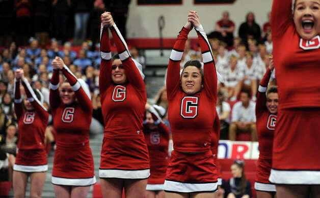 Greenwich cheerleaders Erin Andrews, Lauren Bria, Kaitlyn Cunningham and Mary Andrews, from left, compete during the FCIAC cheerleading championships Saturday, Feb. 2, 2013 at Fairfield Warde High School in Fairfield, Conn. Photo: Autumn Driscoll / Connecticut Post