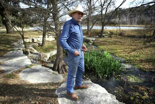"""Joe Smith, who oversees Sunset Cemetery in Mountain Home, TX, stands near a landscaped section of the cemetery, Tuesday, Jan. 29, 2013, where a stream runs through which is fed by a spring on what was the Ellebracht Ranch. Part of the ranch is now owned by the Texas Parks and Wildlife Department which runs the nearby Heart of the Hills Fisheries Science Center.  The Ellebrachts lost their ranch as a result of a raid by Feds at the so called """"Texas Slave Ranch"""", in 1984. Photo: Bob Owen, San Antonio Express-News / © 2012 San Antonio Express-News"""