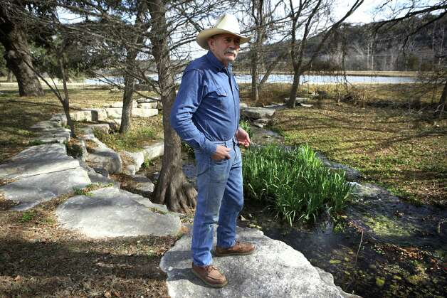 "Joe Smith, who oversees Sunset Cemetery in Mountain Home, TX, stands near a landscaped section of the cemetery, Tuesday, Jan. 29, 2013, where a stream runs through which is fed by a spring on what was the Ellebracht Ranch. Part of the ranch is now owned by the Texas Parks and Wildlife Department which runs the nearby Heart of the Hills Fisheries Science Center.  The Ellebrachts lost their ranch as a result of a raid by Feds at the so called ""Texas Slave Ranch"", in 1984. Photo: Bob Owen, San Antonio Express-News / © 2012 San Antonio Express-News"