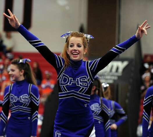 Darien High School cheerleaders compete in the FCIAC cheerleading championships Saturday, Feb. 2, 2013 at Fairfield Warde High School in Fairfield, Conn. Photo: Autumn Driscoll / Connecticut Post