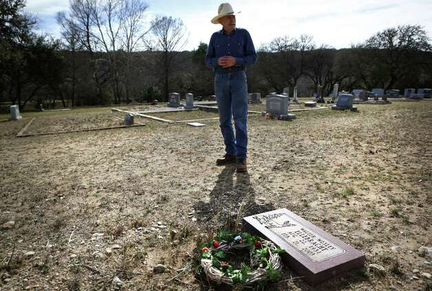 Joe Smith, who oversees Sunset Cemetery in Mountain Home, TX, visits the grave of his friend and neighbor Walter Wesley Ellebracht Sr. Ellebracht is the grandfather of Walter Wesley Ellebracht III, who was killed in an automobile accident Jan. 20 on Highway 290 just out side Fredericksburg. He was just a young boy when his father and grandfather were arrested and their so-called Texas Slave Ranch was raided in 1984. Tuesday, Jan. 29, 2013, Photo: Bob Owen, San Antonio Express-News / © 2012 San Antonio Express-News