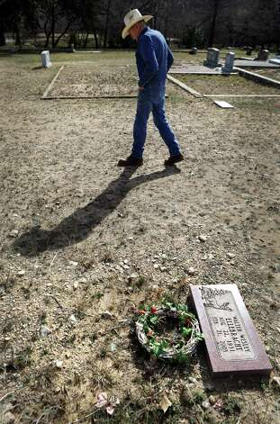Joe Smith, who oversees Sunset Cemetery in Mountain Home, TX, visits the grave of his friend and neighbor Walter Wesley Ellebracht Sr. Tuesday, Jan. 29, 2013.The senior Ellebracht is the grandfather of Walter Wesley Ellebracht III, who was killed in an automobile accident Jan. 20 on Highway 290 just out side Fredericksburg. He was just a young boy when his father and grandfather were arrested and their so-called Texas Slave Ranch was raided in 1984. Photo: Bob Owen, San Antonio Express-News / © 2012 San Antonio Express-News