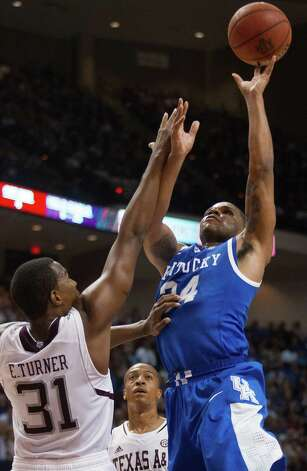 Kentucky guard Julius Mays (34) shoots over Texas A&M guard Elston Turner (31) during the first half of an NCAA college basketball game at Reed Arena on Saturday, Feb. 2, 2013, in College Station, Texas. (AP Photo/Patric Schneider) Photo: Patric Schneider, Associated Press / FR170473 AP