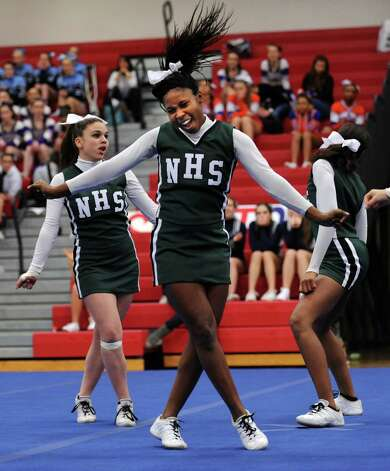 Norwalk's Ny-Aja Boyd competes with her team during the FCIAC cheerleading championships Saturday, Feb. 2, 2013 at Fairfield Warde High School in Fairfield, Conn. Photo: Autumn Driscoll / Connecticut Post