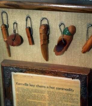 """Key chains made at the """"Texas Slave Ranch"""" still hang in a frame on a wall at Bill's BBQ. Photo: Bob Owen, San Antonio Express-News / © 2012 San Antonio Express-News"""