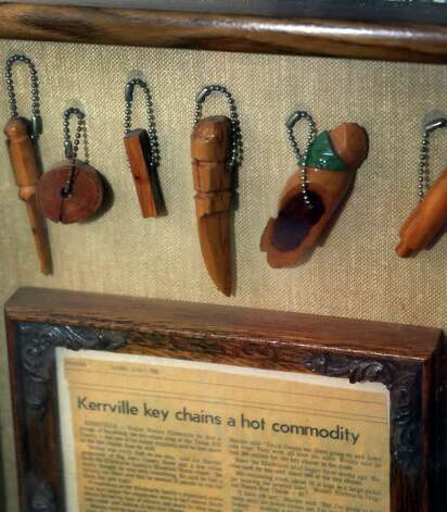 "Key chains made at the ""Texas Slave Ranch"" still hang in a frame on a wall at Bill's BBQ. Photo: Bob Owen, San Antonio Express-News / © 2012 San Antonio Express-News"