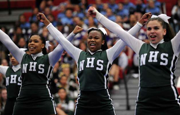 Norwalk's Mariah Smalls, Regine Augustin and Lilliana Garcia, from left, compete in the FCIAC cheerleading championships Saturday, Feb. 2, 2013 at Fairfield Warde High School in Fairfield, Conn. Photo: Autumn Driscoll / Connecticut Post