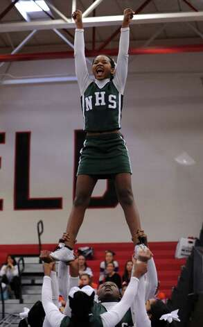 Norwalk High School cheerleaders compete in the FCIAC cheerleading championships Saturday, Feb. 2, 2013 at Fairfield Warde High School in Fairfield, Conn. Photo: Autumn Driscoll / Connecticut Post