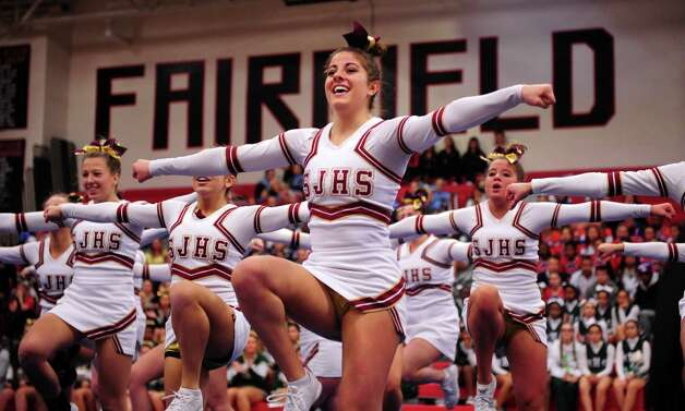 St. Joseph's Sophia Ronga competes with her team during the FCIAC cheerleading championships Saturday, Feb. 2, 2013 at Fairfield Warde High School in Fairfield, Conn. Photo: Autumn Driscoll / Connecticut Post
