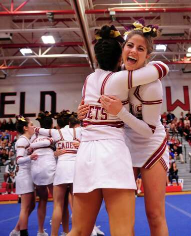 St. Joseph's Sophia Ronga, right, hugs Marissa Trafecante after completing their routine during the FCIAC cheerleading championships Saturday, Feb. 2, 2013 at Fairfield Warde High School in Fairfield, Conn. Photo: Autumn Driscoll / Connecticut Post