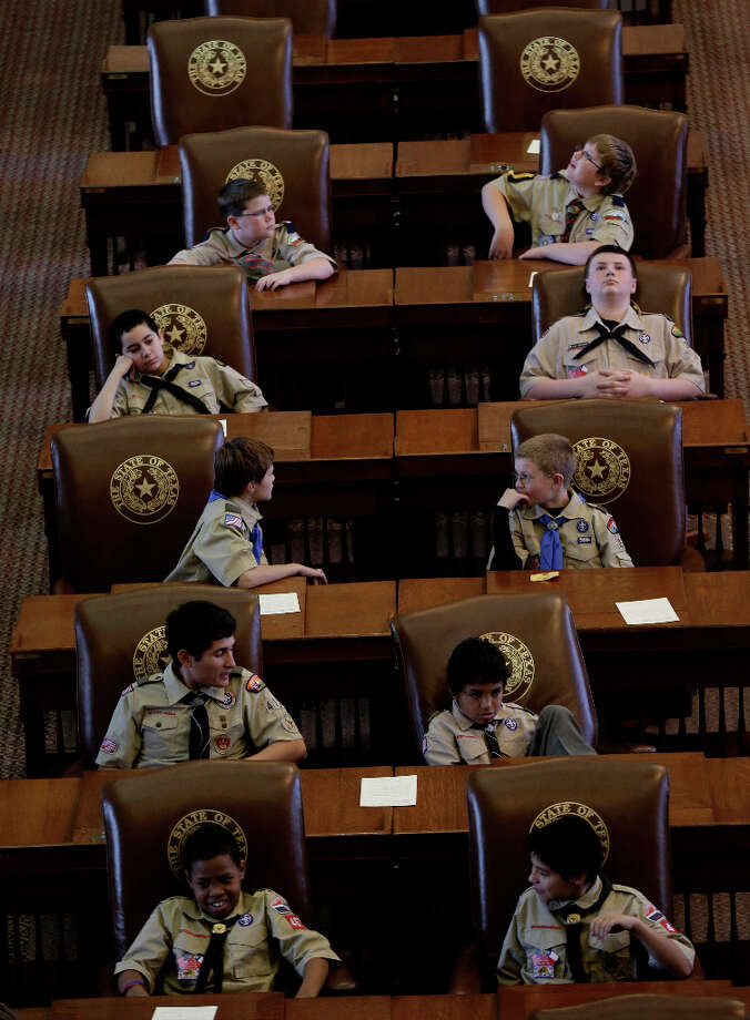 Scouts sit in the House Chambers at the Texas State Capitol as they wait to hear Gov. Rick Perry speak during the annual Boy Scouts Parade and Report to State, Saturday, Feb. 2, 2013, in Austin, Texas. Perry says he hopes the Boy Scouts of America doesn't move soften its mandatory no-gays membership policy. Photo: Eric Gay, Associated Press / AP