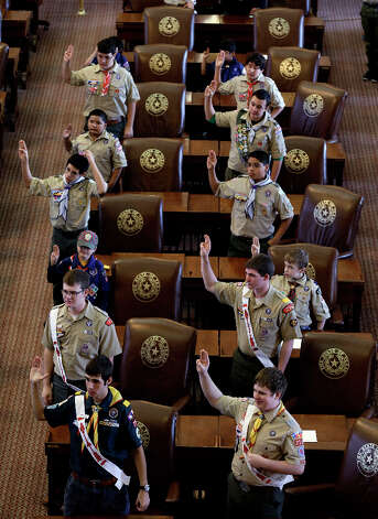 Boy Scouts recite the Scout Oath during the annual Boy Scouts Parade and Report to State in the House Chambers at the Texas capitol, Saturday, Feb. 2, 2013, in Austin, Texas. Gov. Rick Perry said emphatically Saturday that the Boy Scouts of America shouldn't soften its strict no-gays membership policy, and suggested that bending the organization to the whims of popular culture is wrong. Photo: Eric Gay, Associated Press / AP