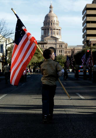 Boy Scouts carry U.S. flags up Congress Avenue towards the Texas Capitol during the annual Boy Scouts Parade and Report to State, Saturday, Feb. 2, 2013, in Austin, Texas. Gov. Rick Perry said emphatically Saturday that the Boy Scouts of America shouldn't soften its strict no-gays membership policy, and suggested that bending the organization to the whims of popular culture is wrong. Photo: Eric Gay, Associated Press / AP