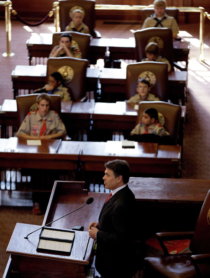 Gov. Rick Perry addressed the Boy Scouts during the Parade and Report to State in the House Chambers at the Texas State Capitol, Saturday, Feb. 2, 2013, in Austin, Texas. Perry says he hopes the Boy Scouts of America doesn't move soften its mandatory no-gays membership policy. Photo: Eric Gay, Associated Press / AP