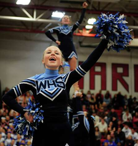 Wilton High School's Lydia Bates competes in the FCIAC cheerleading championships Saturday, Feb. 2, 2013 at Fairfield Warde High School in Fairfield, Conn. Photo: Autumn Driscoll / Connecticut Post