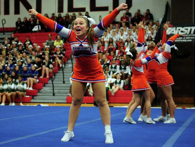 Danbury's Brianna Syryla competes with her team during the FCIAC cheerleading championships Saturday, Feb. 2, 2013 at Fairfield Warde High School in Fairfield, Conn. Photo: Autumn Driscoll / Connecticut Post