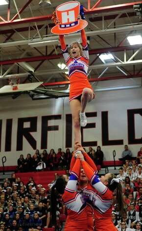 Danbury's Kennedy Shook competes with her team during the FCIAC cheerleading championships Saturday, Feb. 2, 2013 at Fairfield Warde High School in Fairfield, Conn. Photo: Autumn Driscoll / Connecticut Post