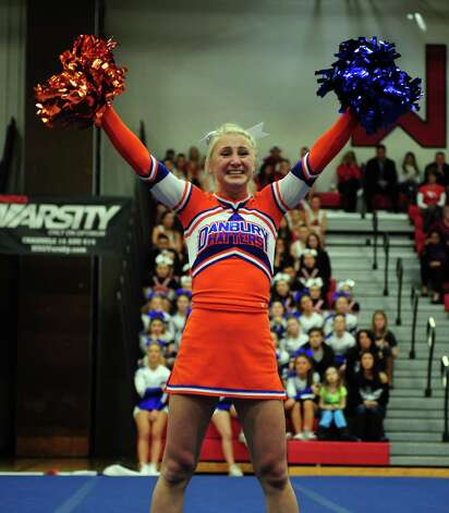 Danbury's Kiki Melanophy competes with her team during the FCIAC cheerleading championships Saturday, Feb. 2, 2013 at Fairfield Warde High School in Fairfield, Conn. Photo: Autumn Driscoll / Connecticut Post