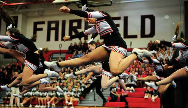 Stamford's Chrishima Richards competes with her team during the FCIAC cheerleading championships Saturday, Feb. 2, 2013 at Fairfield Warde High School in Fairfield, Conn. Photo: Autumn Driscoll / Connecticut Post