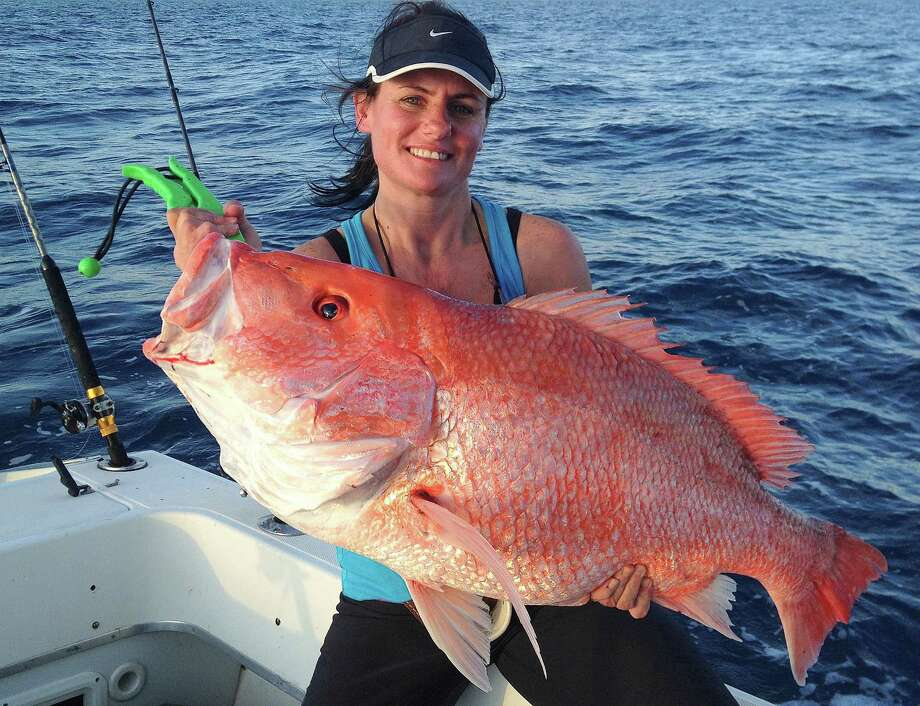 Tracy Allred holds a 38.25-inch red snapper she caught about 80 miles off Sabine Pass in January. The fish, which may have topped the Texas red snapper record of 38.13 pounds, was released because red snapper season is closed in Gulf water under federal control. Photo: Picasa
