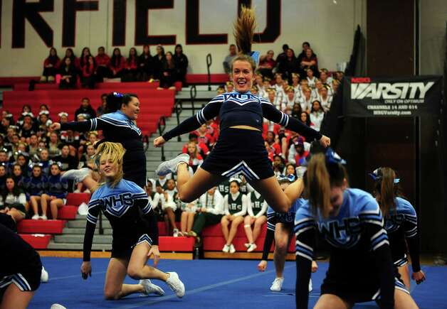 Wilton High School's Kate Cella, center, competes with her team during the FCIAC cheerleading championships Saturday, Feb. 2, 2013 at Fairfield Warde High School in Fairfield, Conn. Photo: Autumn Driscoll / Connecticut Post