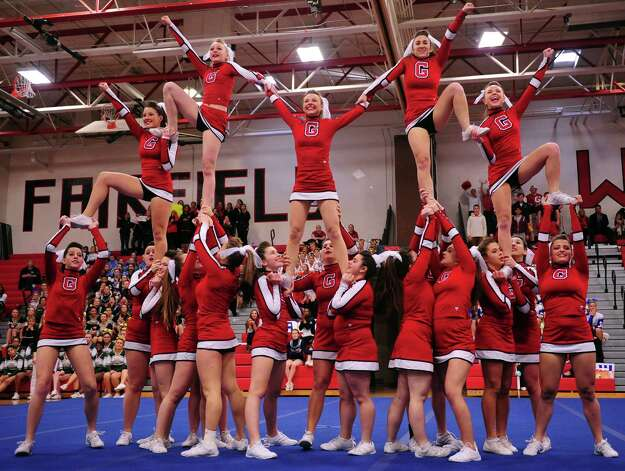 Greenwich High School cheerleaders compete in the FCIAC cheerleading championships Saturday, Feb. 2, 2013 at Fairfield Warde High School in Fairfield, Conn. Photo: Autumn Driscoll / Connecticut Post