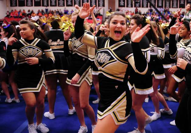 Trinity High School cheerleaders dance as they wait for results during the FCIAC cheerleading championships Saturday, Feb. 2, 2013 at Fairfield Warde High School in Fairfield, Conn. Photo: Autumn Driscoll / Connecticut Post