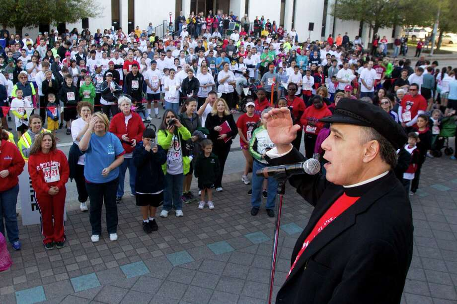 Cardinal Daniel N. DiNardo says a blessing before the start of the 8th Annual Steps for Students 5K Run/Walk Saturday, Feb. 2, 2013, in Houston. Photo: Brett Coomer, Houston Chronicle / © 2013 Houston Chronicle