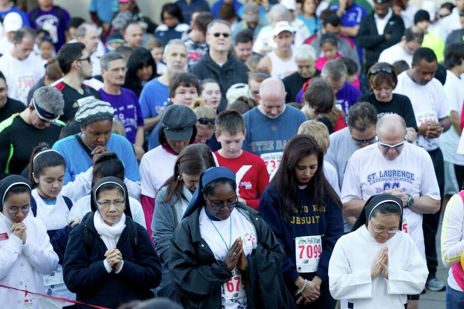 Participants in the 8th Annual Steps for Students 5K Run/Walk say a prayer before the run Saturday, Feb. 2, 2013, in Houston. Photo: Brett Coomer, Houston Chronicle / © 2013 Houston Chronicle
