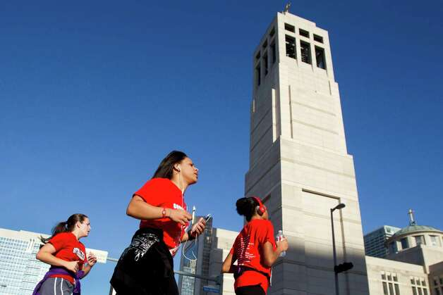 Runners race past the Co-Cathedral during the 8th Annual Steps for Students 5K Run/Walk Saturday, Feb. 2, 2013, in Houston. Photo: Brett Coomer, Houston Chronicle / © 2013 Houston Chronicle