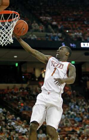 Texas guard Sheldon McClellan gets a layup against TCU during the first half of an NCAA college basketball game, Saturday, Feb. 2, 2013, in Austin, Texas. (AP Photo/Michael Thomas) Photo: Michael Thomas, Associated Press / FR65778 AP