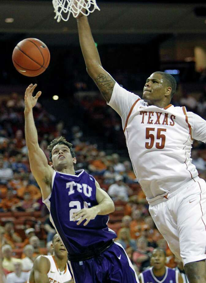 Texas center Cameron Ridley, right, goes up for a block against TCU guard Chris Zurcher during the first half of an NCAA college basketball game, Saturday, Feb. 2, 2013, in Austin, Texas. (AP Photo/Michael Thomas) Photo: Michael Thomas, Associated Press / FR65778 AP